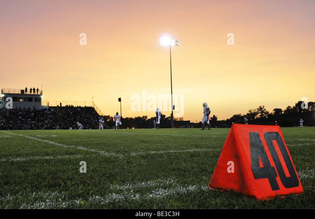 Football field at the 40th yard at night - Stock Image