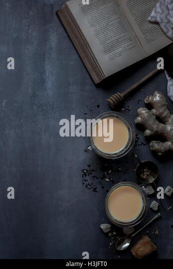 Chai tea and historic book - Stock Image