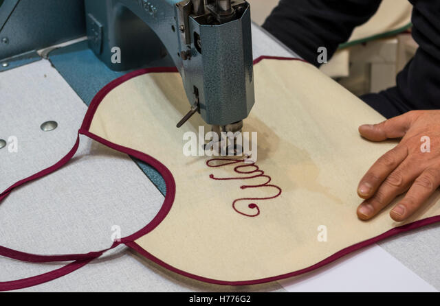 Embroidery of a name in script typeface using a stitching machine. - Stock Image