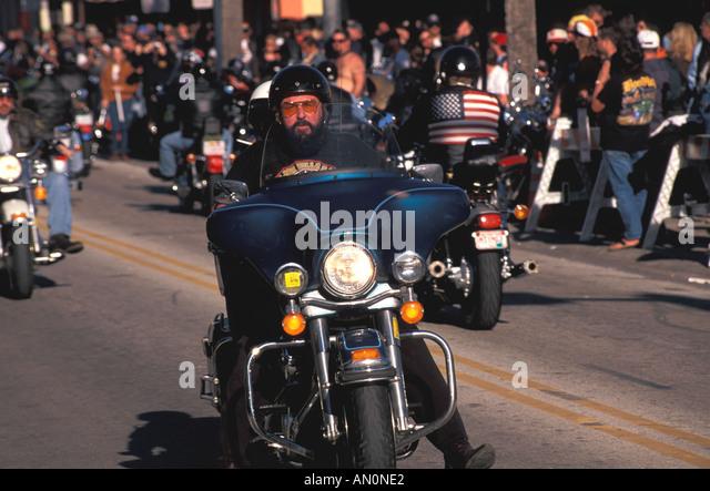 Daytona Beach Florida fl bike week crowds bikers parading on main street annual motorcycle party festival - Stock Image