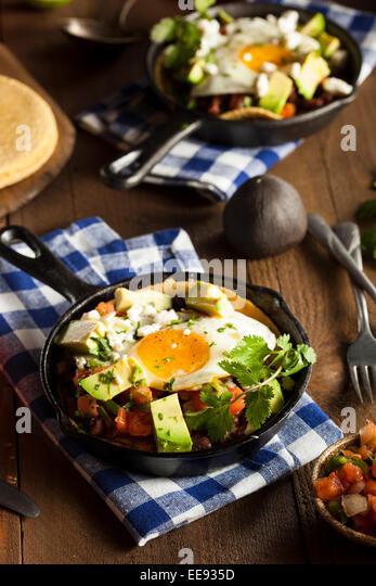 Homemade Heuvos Rancheros with Avocado and Cilantro - Stock Image