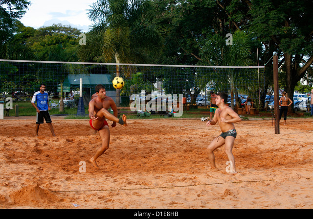Men playing foot volleyball at Parque Cidade Sarah Kubitschek, Brasilia, Brazil, South America - Stock Image