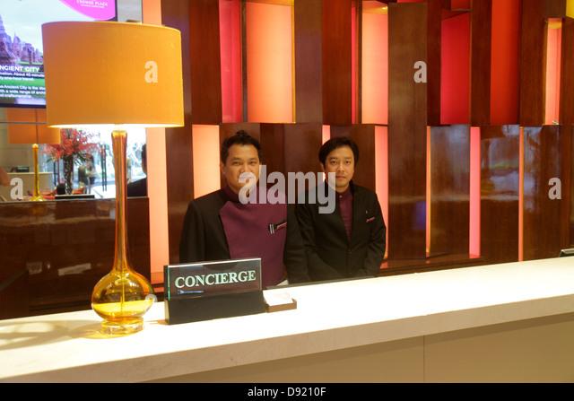 Bangkok Thailand Silom Rama IV Road Crowne Plaza Bangkok Lumpini Park lobby front desk check in concierge Asian - Stock Image