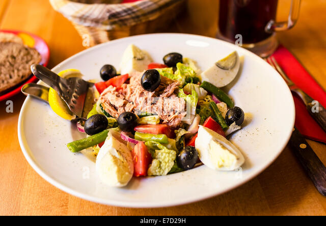 Salad with tuna, tomatoes, basil and onion. - Stock Image