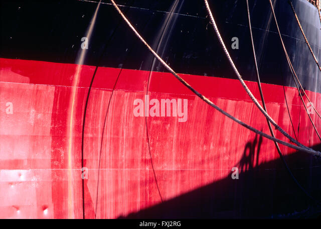 Red & black hull of large freighter ship; Genoa; Italy - Stock Image