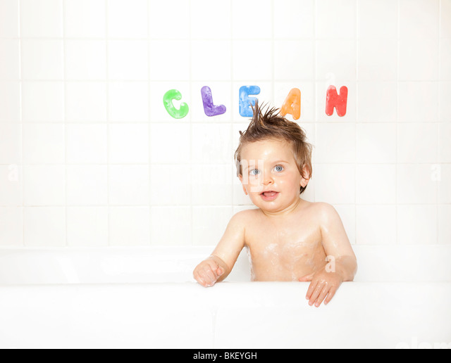 Baby boy in bathtub - Stock Image