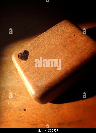 Small wooden box with a heart burned into it. - Stock Image