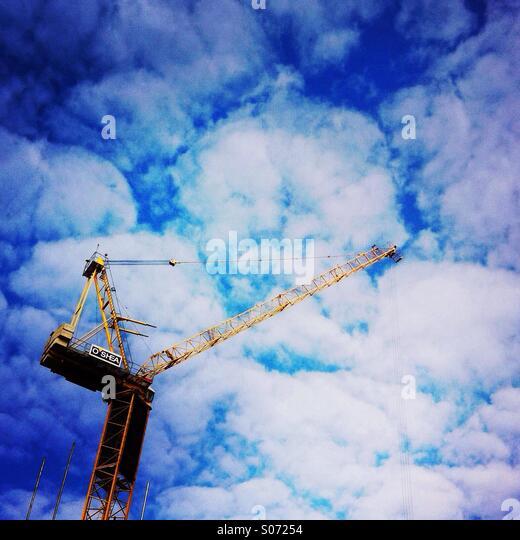 A construction crane and clouds. London, UK. - Stock-Bilder