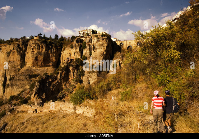 Spain Andalucia Ronda Parador Puente Nuevo spanning the gorge of the Rio Guadalevin at sunset - Stock Image