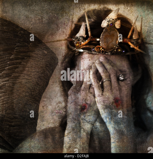 Shamanic angel martyr hiding face with stigmata on the hands. Photo base illustration. - Stock Image