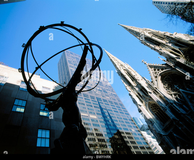 atlas statue overview New York Saint Patrick cathedral USA America North America skyscraper block of flats - Stock Image