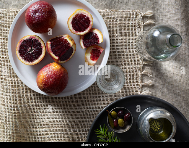 Blood oranges on plate - Stock Image