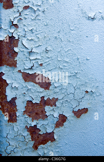 blue surface of an old fence, rusty textures - Stock Image