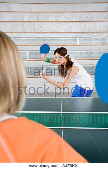 Two women playing table tennis - Stock Image