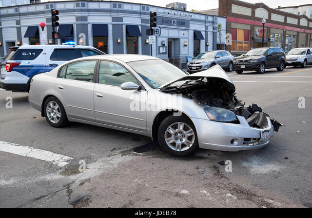 accident damaged car immobilised due to crash at intersection in suburbs of Boston USA - Stock Image