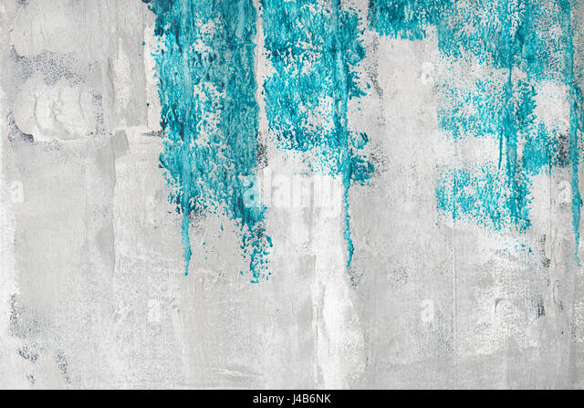 Blue paint on a grunge wall with weathered surface in bright colors - Stock Image