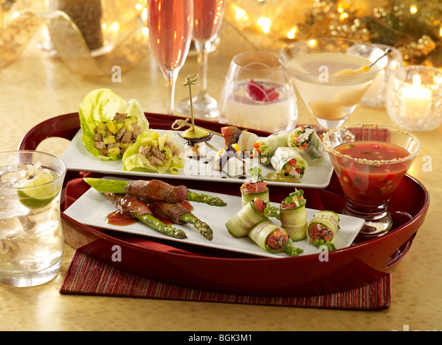 Assorted appetizers and cocktails in a festive party settings - Stock Image