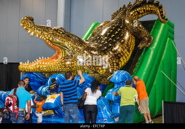 Miami Beach Florida Convention Center centre Discover the Dinosaurs event giant slide alligator children - Stock Image