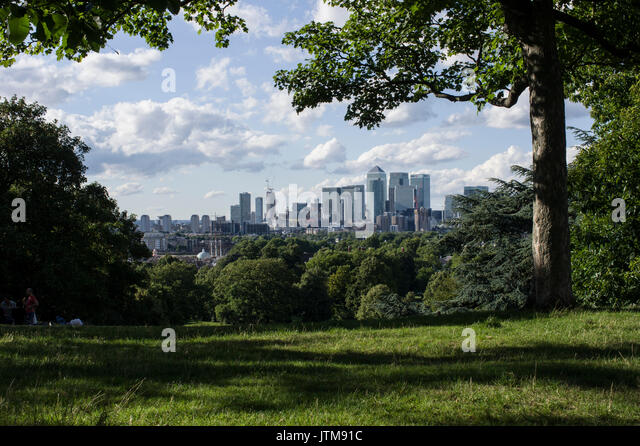 View on London City and Canary Wharf from Blackheath Park in Greenwich, South London - Stock Image