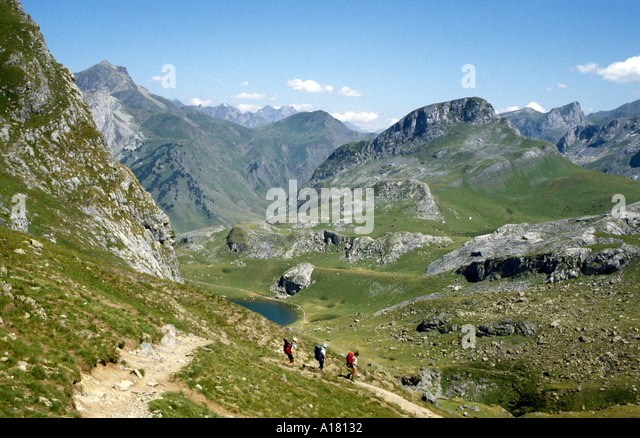 Walkers on the Tour du Pic du Midi d'Ossau, near Lac Casterau, Pyrenees, France - Stock Image