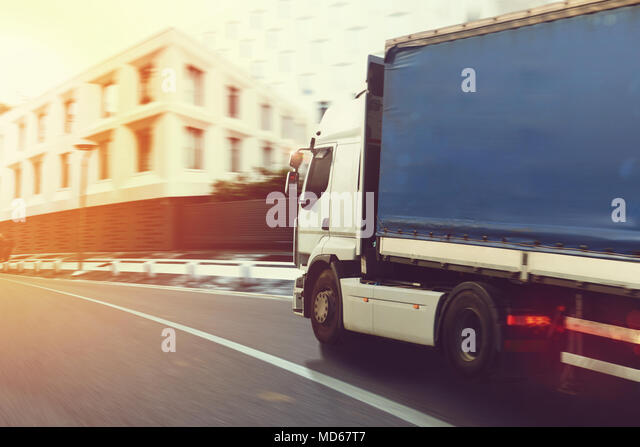 Fast truck on a city road delivering - Stock Image