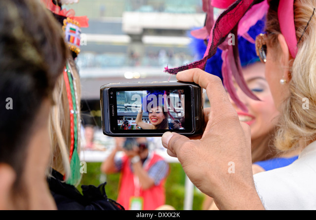 Female spectators at Dubai World Cup horse racing championship at Meydan racecourse in Dubai United Arab Emirates - Stock Image