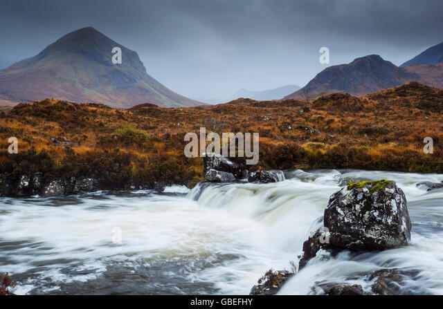 Raging torrents in River Sligachan, looking into Glen Sligachan with Marsco on the left and the Cuilllin Hills on - Stock Image