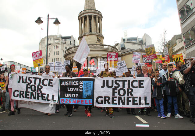 London, UK - 1 July 2017 - Demonstrators march holding a 'Justice for Grenfell' banner at the march in the - Stock Image