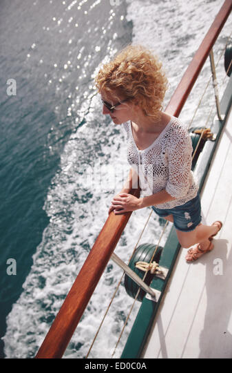 Greece, Santorini, Elevated view of young woman on ship - Stock Image