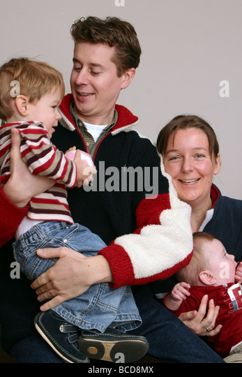 ADHD family heredity: Adhd runs the family, image of ADHD parents with two hyperactive ADHD children - Stock Image