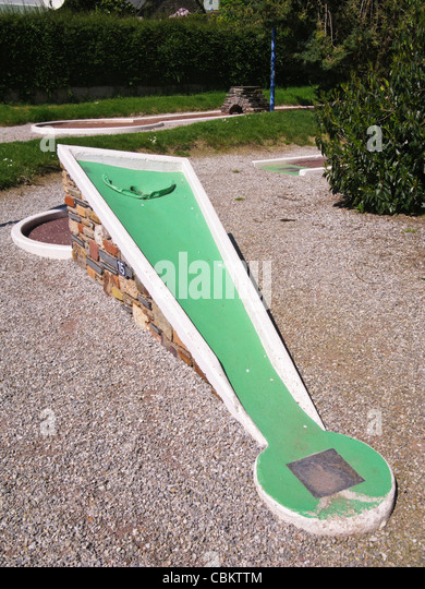 Hole on a crazy golf course - Stock Image