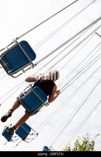 Girl Sitting in Amusement Park Ride, Bad Woerishofen, Bavaria, Germany, Europe - Stock-Bilder
