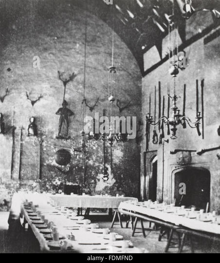 Black and white archive photograph of the Great Hall set for tea c.1860 (from the Victorian Somers-Cocks albums - Stock-Bilder