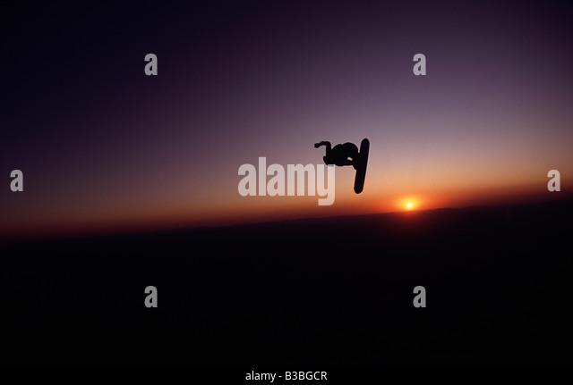A Skysurfer uses the last bit of daylight to surf through the Arizona sky - Stock Image