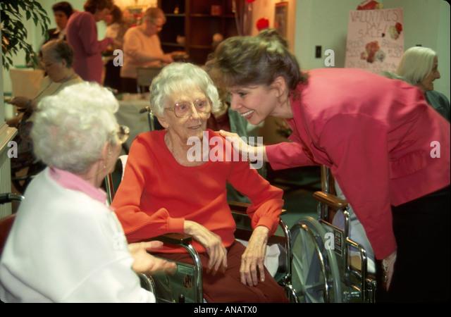 New Jersey Morristown nursing home residents seniors elderly women aide aging healthcare staff wheelchair - Stock Image