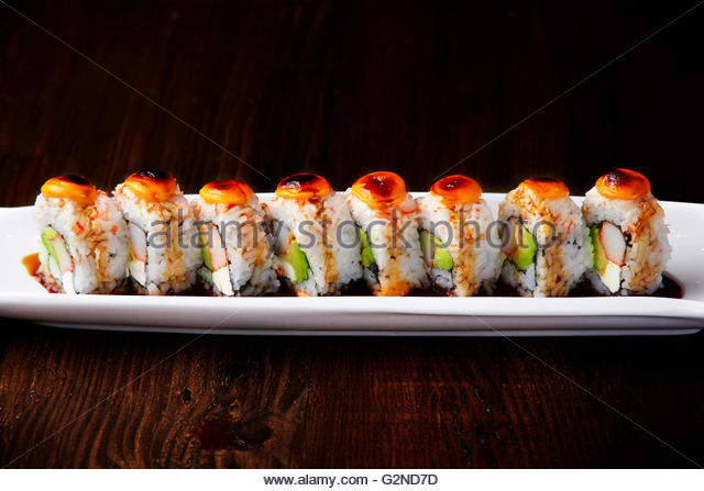 Volcano sushi roll, spicy avocado salmon roll - Stock Image