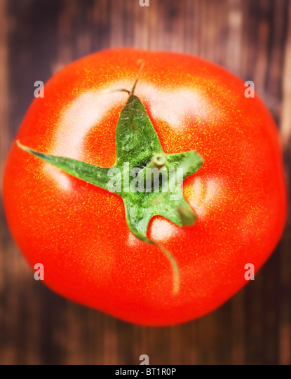 Closeup on red tomato with shallow DOF - Stock Image