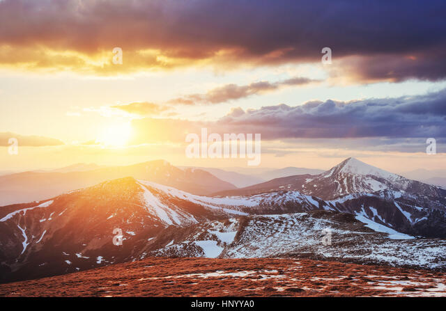 Colorful spring sunset over the mountain ranges in the national  - Stock Image