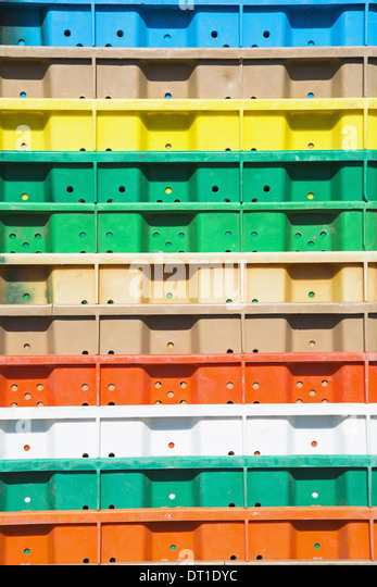 Washington State USA Stacks multi-colored containers for grape harvest - Stock Image