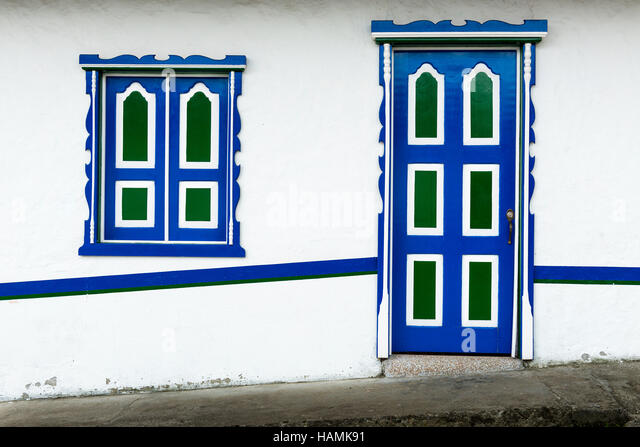Detail of a wooden door and window painted in bright colors in a traditional colonial house in the town of Salento, - Stock-Bilder