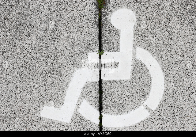 Wheelchair Symbol On Concrete Berlin Germany - Stock Image