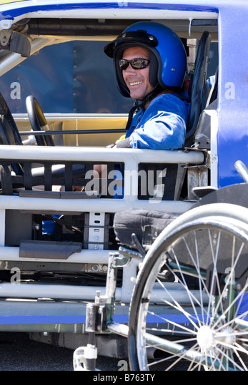Smiling male disability auto racer - Stock Image