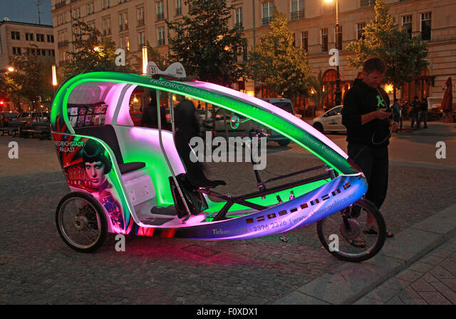 Berlin city Cycle Rickshaw at night, Germany - lights on - Stock Image