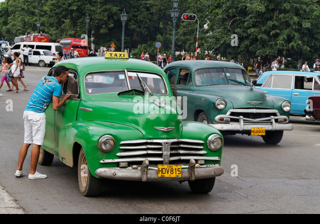 Oldtimer Taxi in Havanna Center on Paseo de Marti near Capitol, Cuba - Stock Image