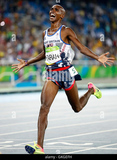 Rio De Janeiro, Brazil. 20th Aug, 2016. Britain's Mohamed Farah reacts after crossing the finish line during - Stock-Bilder