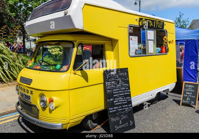 A mobile catering van offering vegetarian and vegan food. - Stock Image