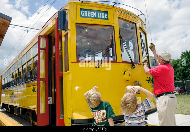 Little Rock Arkansas World Avenue River Rail Electric Streetcar man boy children conductor heritage trolley replica - Stock Image