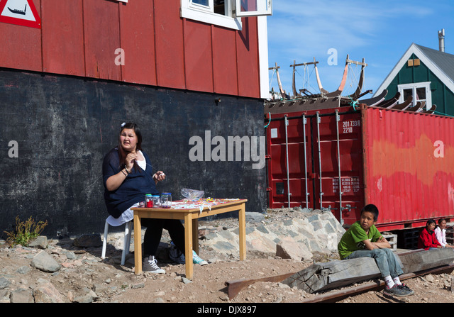 Local woman demonstrating the art of beading, Ittoqqortoormiit, Greenland - Stock Image