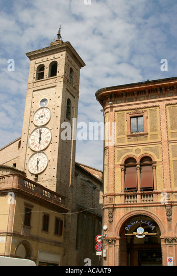 Quirky triple faced clock is a landmark in the charming historic city of Tolentino in Le Marche Italy - Stock Image