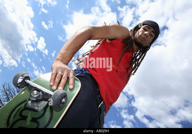 Low angle view of skateboarder - Stock Image